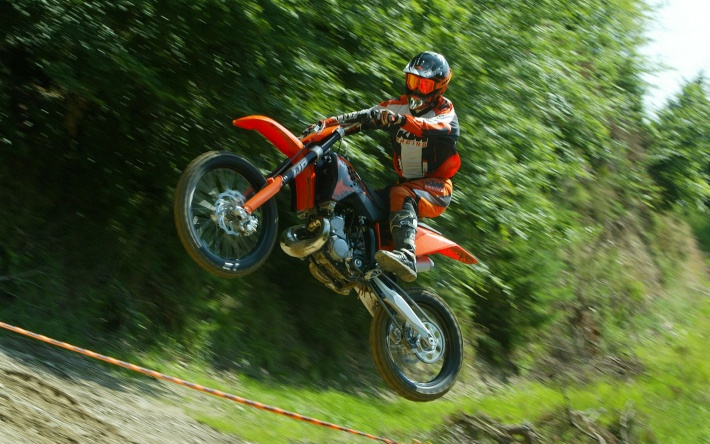 Motocross - Orange KTM in Flight