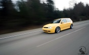 Yellow VW Golf on the Track